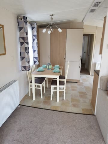 Dining table in kitchen and separate from lounge