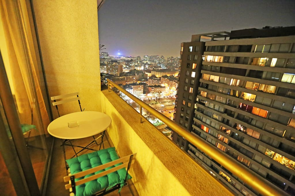 Apartment balcony (26th floor), view Santiago Center, Entel Tower, Forestal Park and Mapocho River