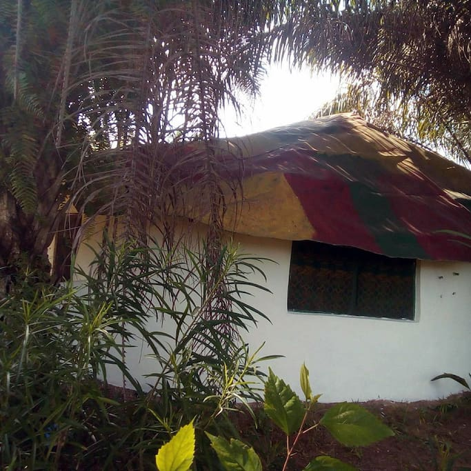 Conical round house with funky roof