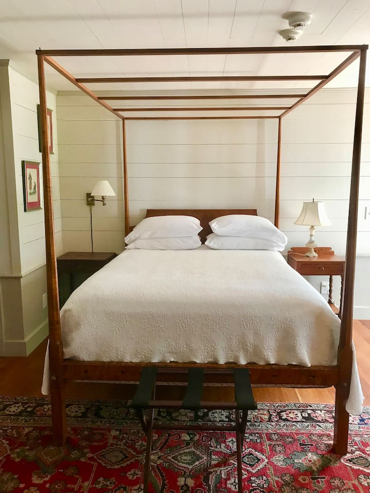 Queen size bed with all cotton bedding. Tiger maple 4 poster bed crafted in Vermont