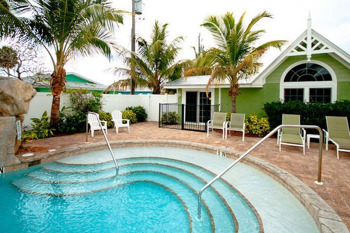 Dog-friendly, Gulf side condo w/ a shared pool - just a short walk to the beach