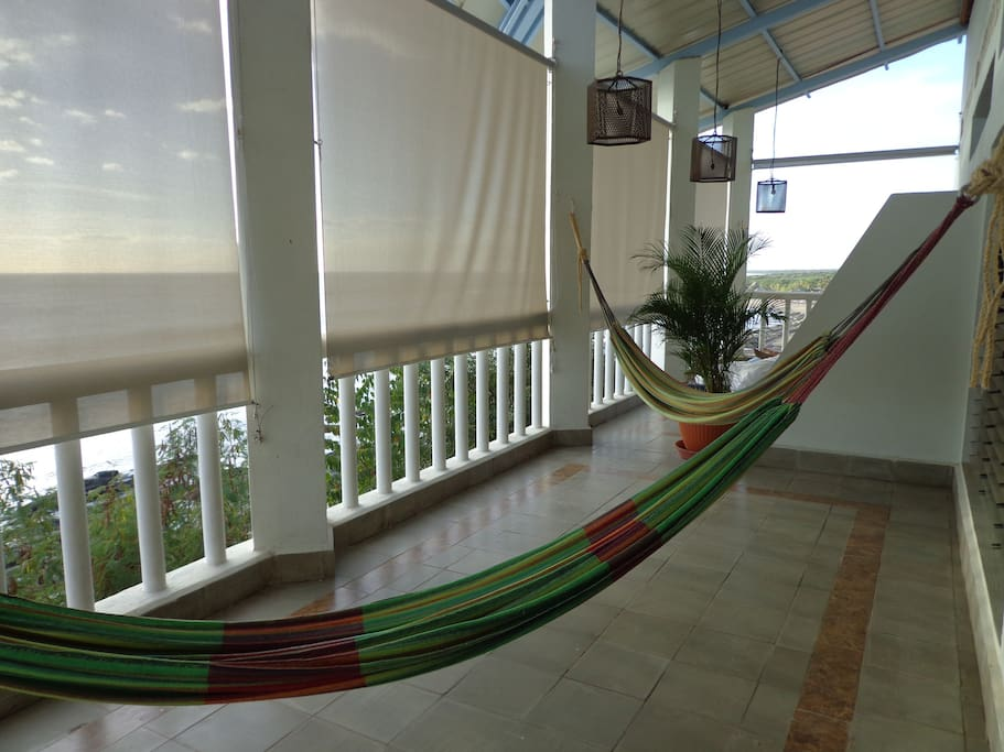Terrace of duplex room. Each room in B&B has own terrace space with hammocks.