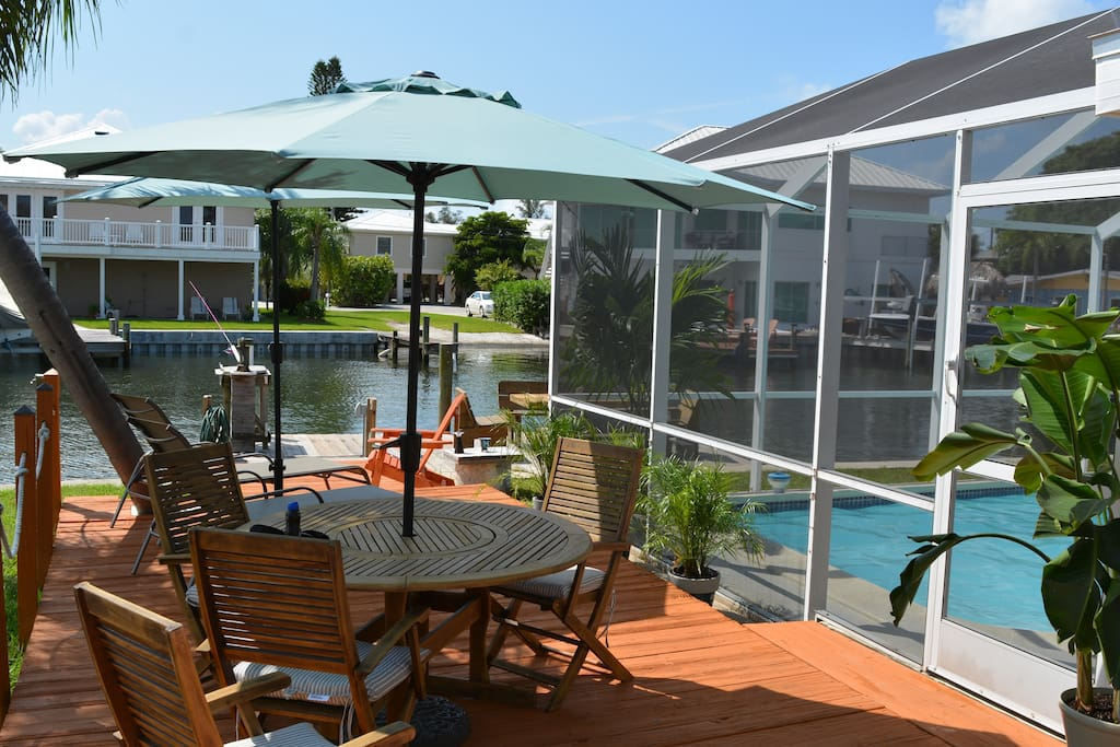 Enjoy lunches and dinners on the deck next to pool and water