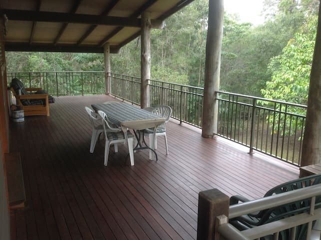 back verandah with table, bbq and sofa