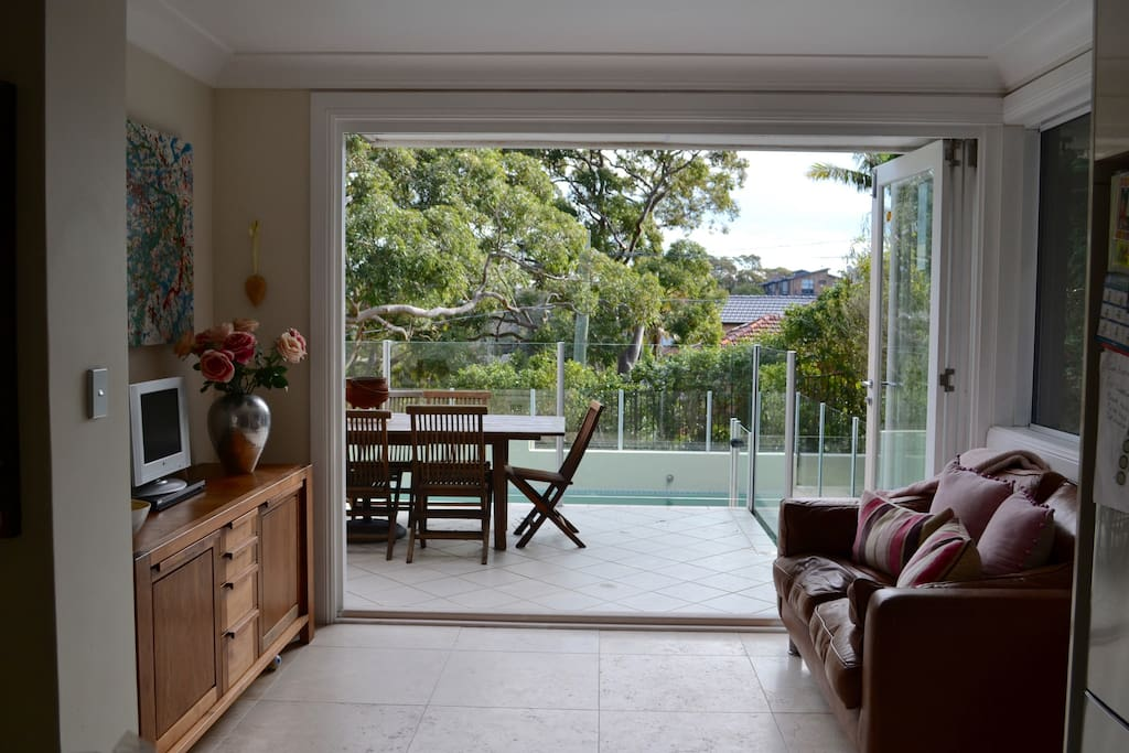 Bi fold doors to outside eating area and pool