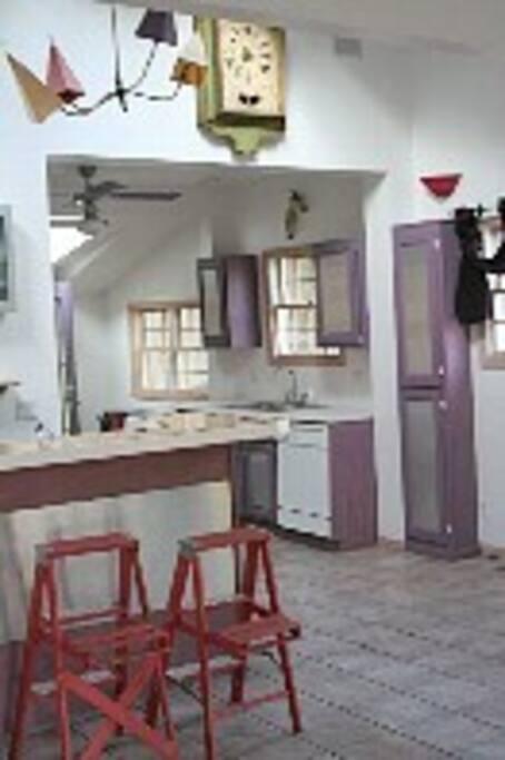 Entertainment room toward kitchen