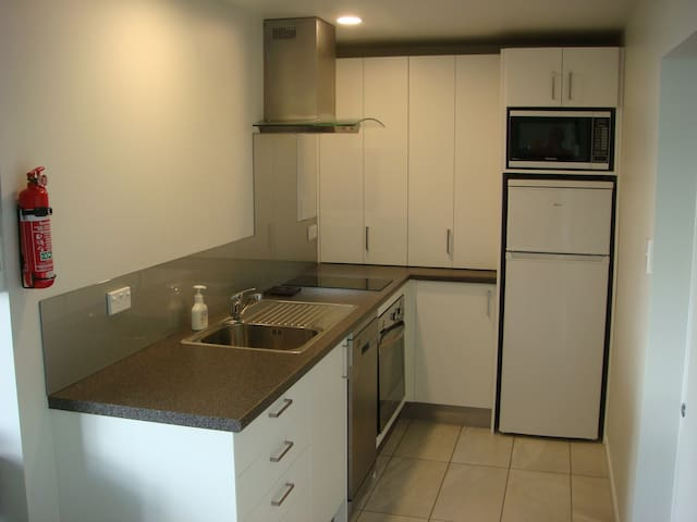 Fully equipped kitchen including dishwasher and full oven  and induction hob