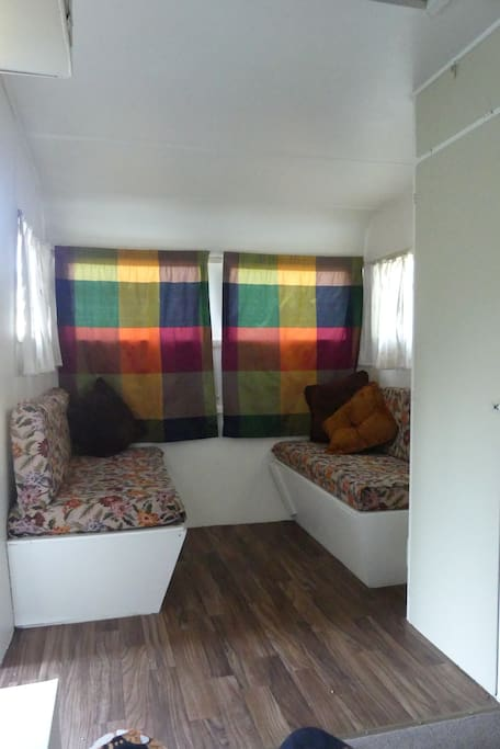 Couches in caravan make up to another double bed.