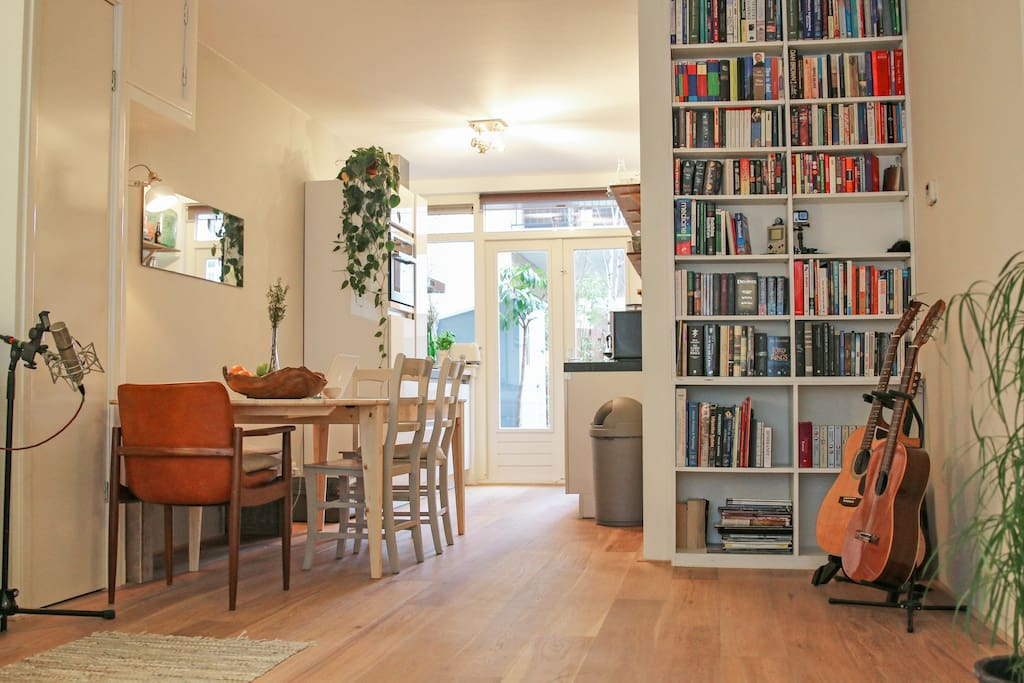 The living room: is large and goes into the kitchen, which has doors to the small, sunny garden