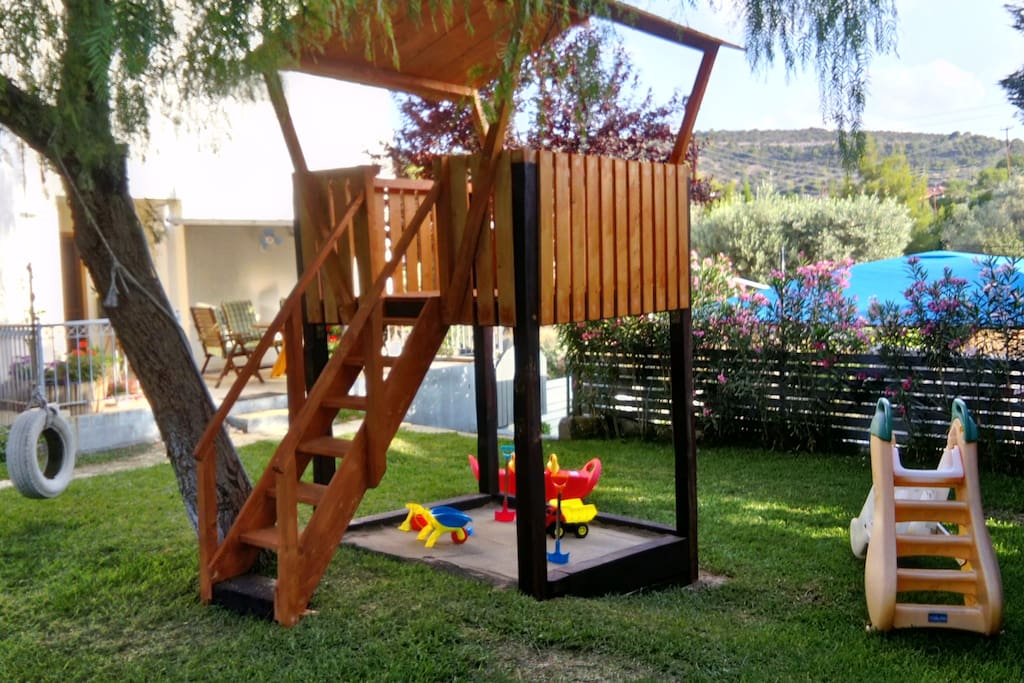 sand box and slide to keep kids busy