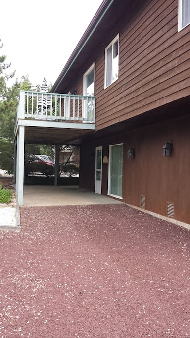 Car port, driveway, and balcony