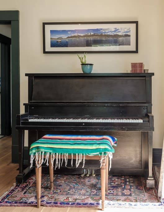 My upright piano! Please feel free to play any of the instruments around the house.
