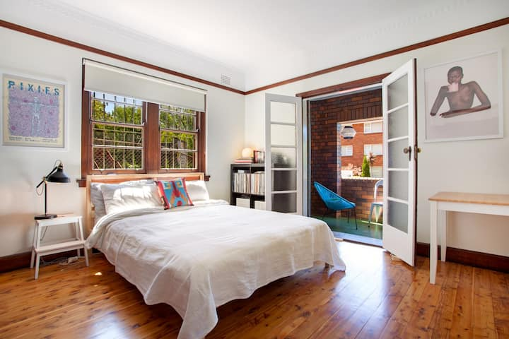 Cozy queen bedroom in vibrant Summer Hill