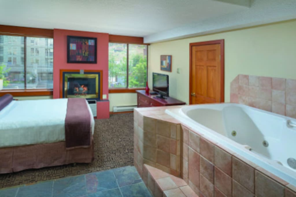 Master Bedroom King with hot tub, fireplace and television.