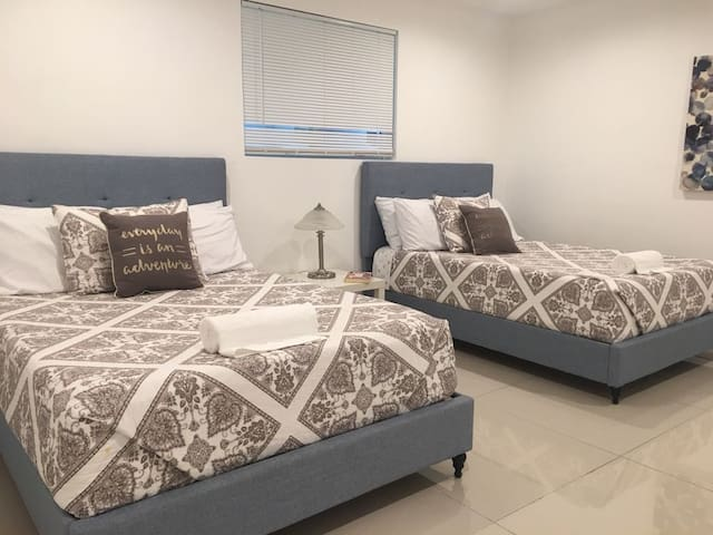 2- bedroom with 2 full size beds and TV