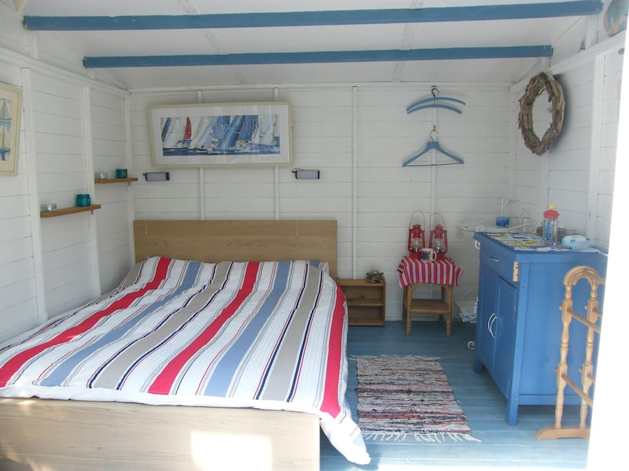 Comfy double bed in nautical themed hut