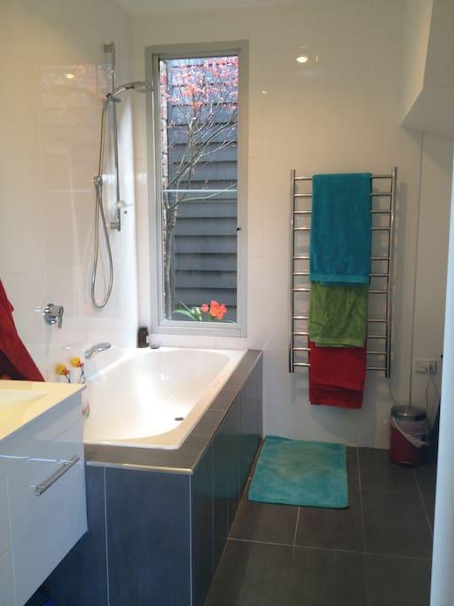 Downstairs bathroom includes washing machine, dryer, sink, toilet and bath.
