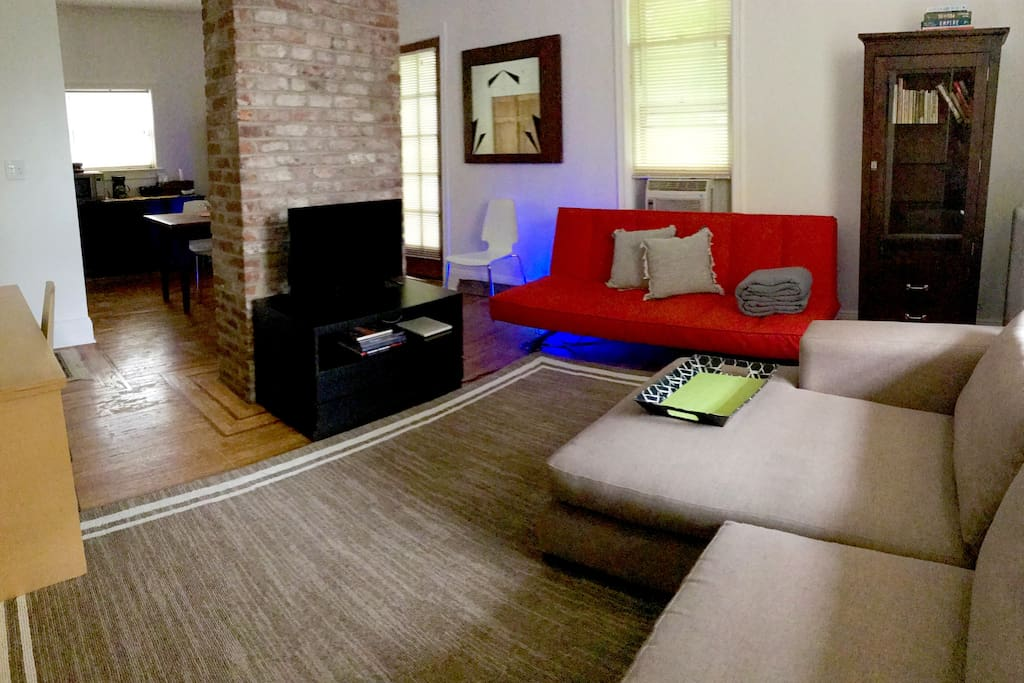 Living Room with Red sofa folds out to queen bed