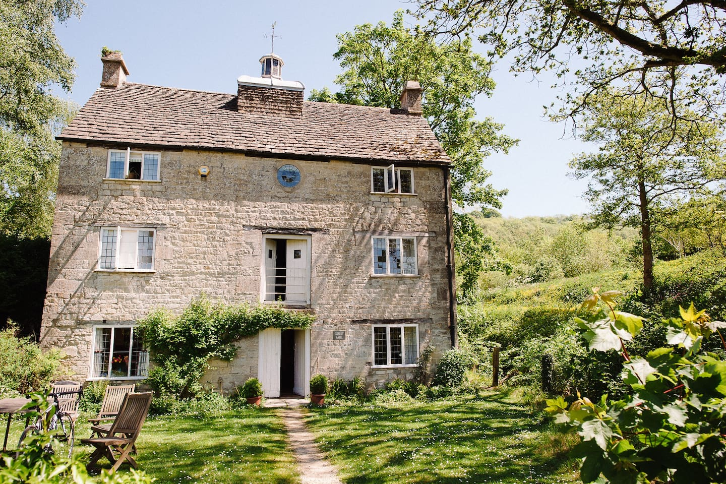 Exterior of the Grist Mill, a listed building dating to around 1726 and made of Cotswold limestone