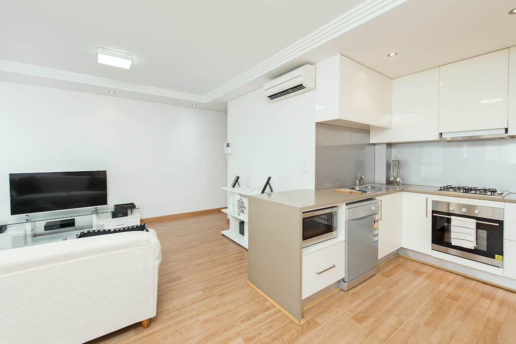 The open plan design of the living space + kitchen