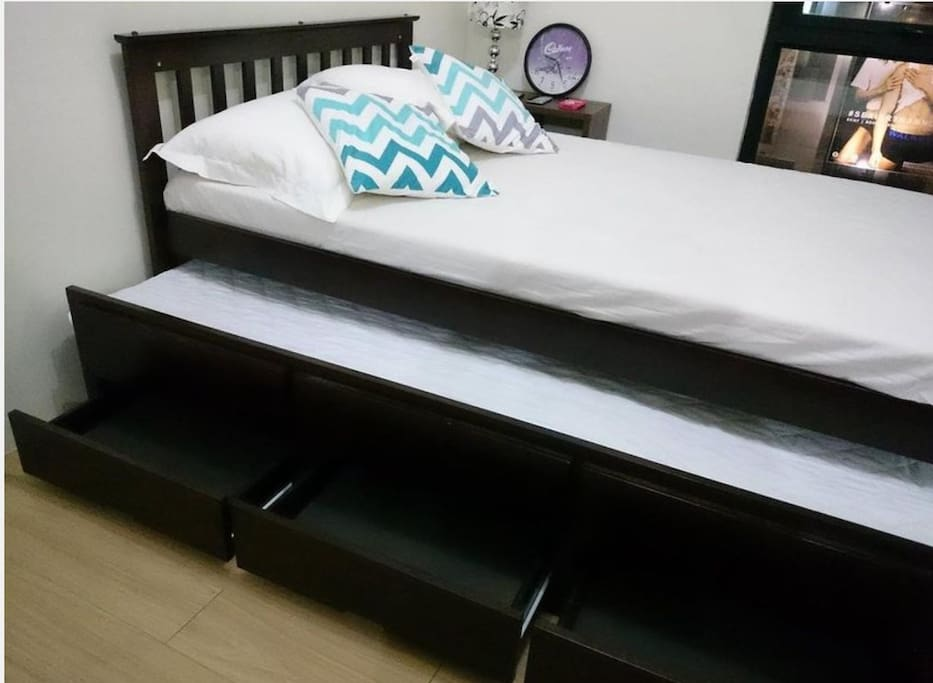 Transformer bed into 2 double bed with draws