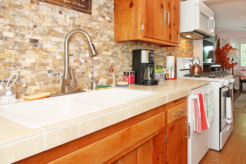 "Big kitchen sink with gorgeous tile back splash. ""The Keurig coffee maker and free coffee and tea was very nice to have."" - Frank (guest)"