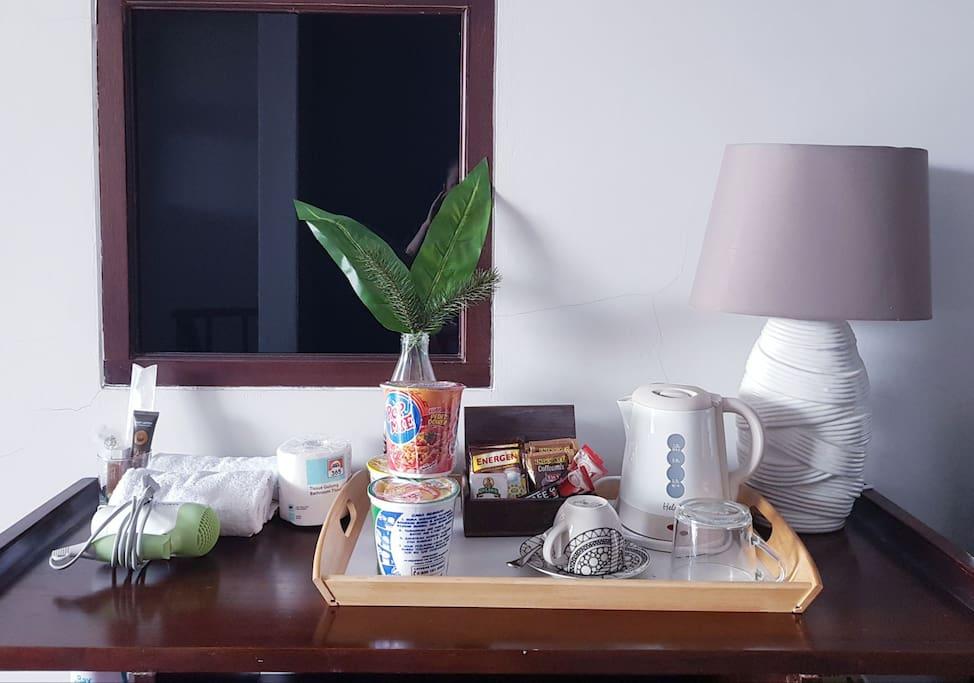 Toiletries, hairdryer, snack, tea, coffee