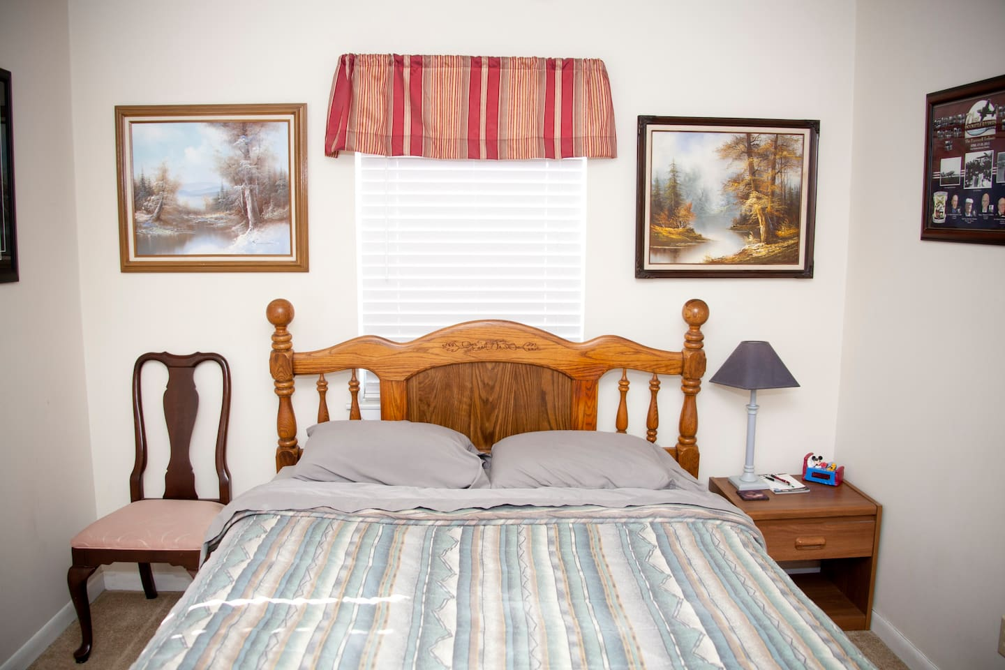 Queen size bed with night stand & chair.