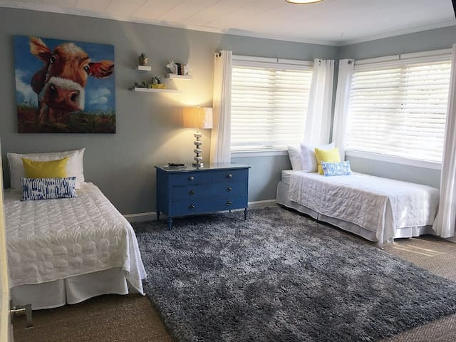 """This spacious, cheerful bedroom is great for kids and others who don't mind sharing a room but want to maintain a little """"personal distance."""""""