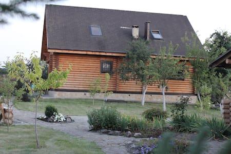 Log cabin with lake, sauna, jacuzzi - Десна
