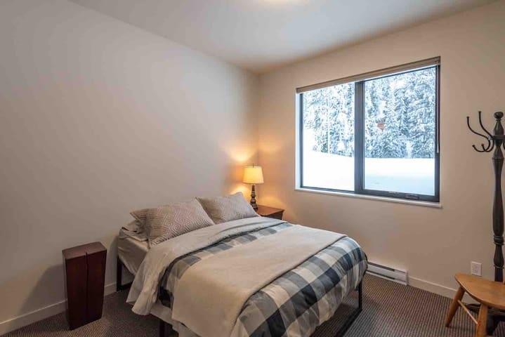 Bedroom two, queen bed, dresser & mirror, & plenty of room for your gear!