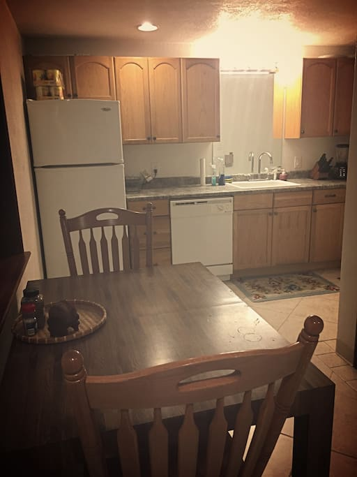 Fully stocked with all the appliances: dishwasher, oven/stove, coffee pot, etc.