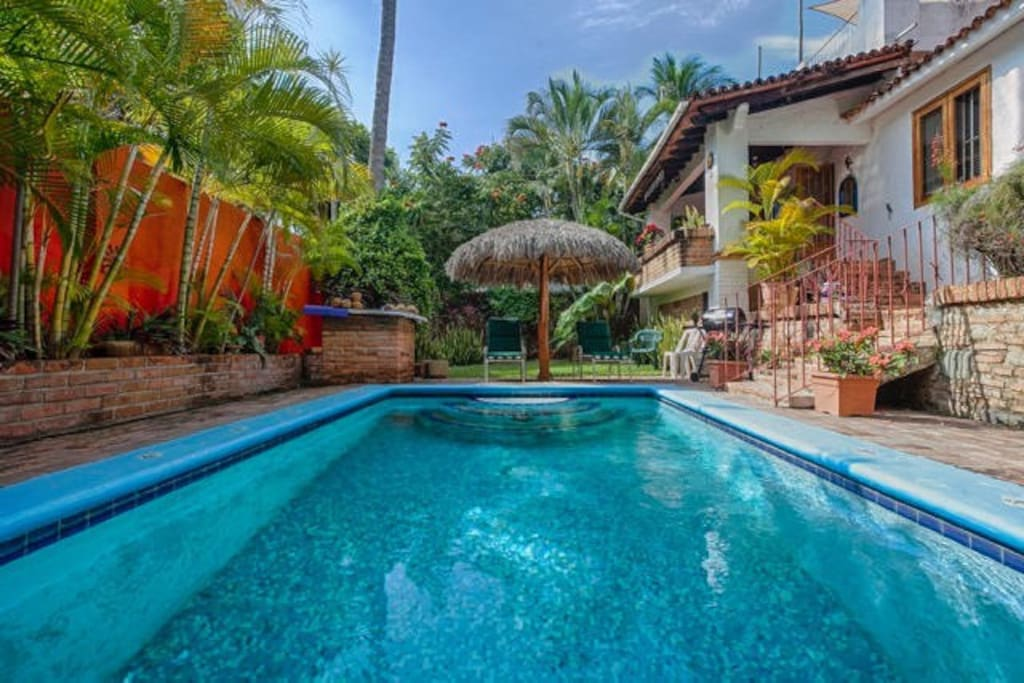 Private pool, lush tropical plants and terrace