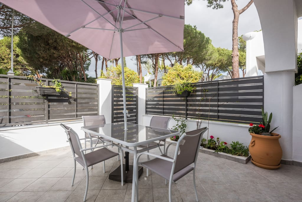 3 large terraces for private use - shown is front with garden and dining,  locked gate