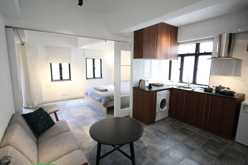 Kitchen fully equipped with fridge, cooker, washing machine, toaster, kettle & crockery.