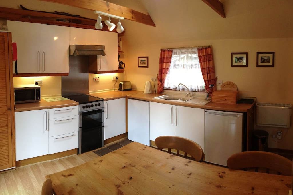 Spacious kitchen-diner fully equipped with garden views