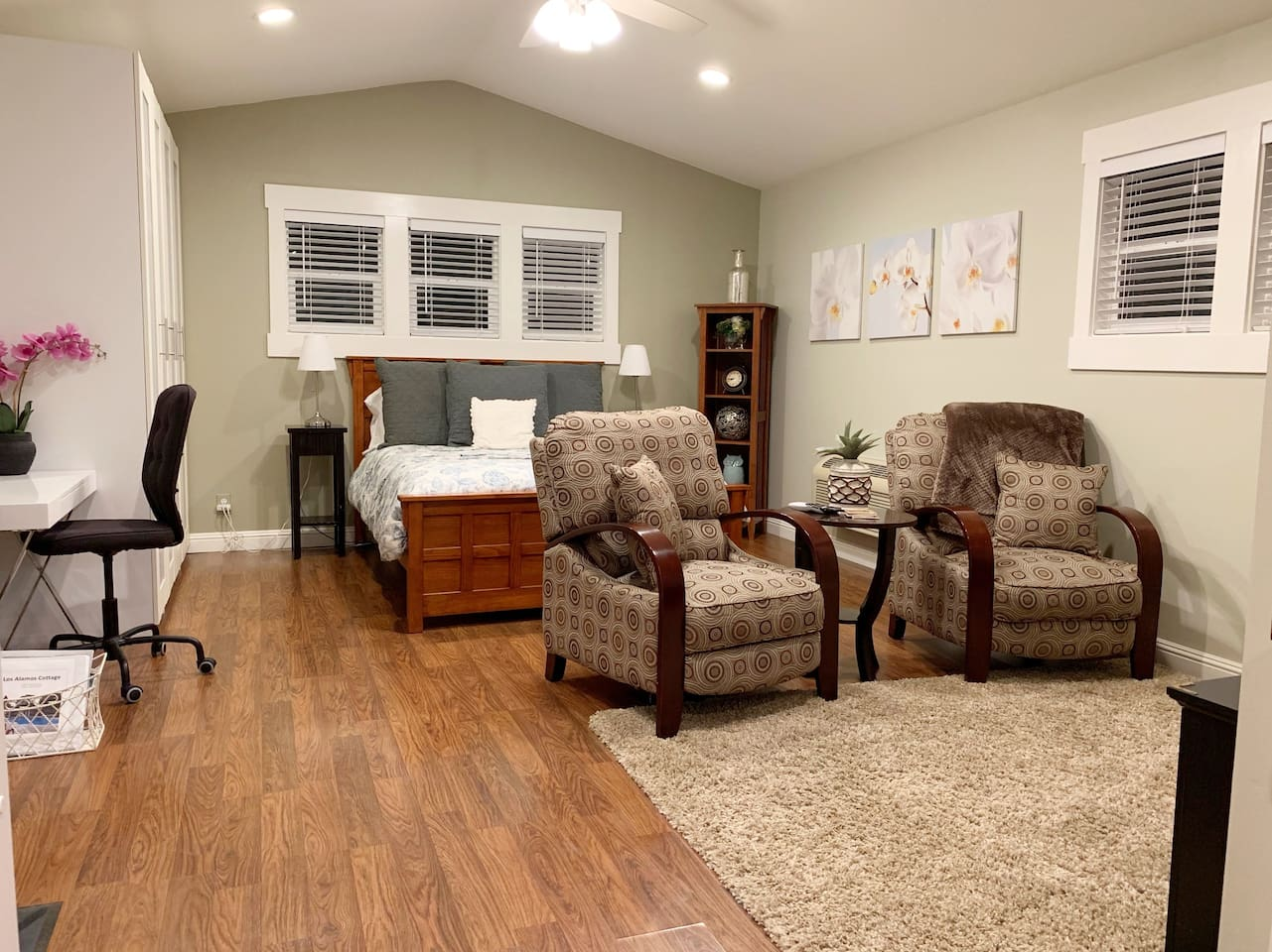 The space is 440 square feet. The vaulted ceilings and lots of windows make it feel even larger.