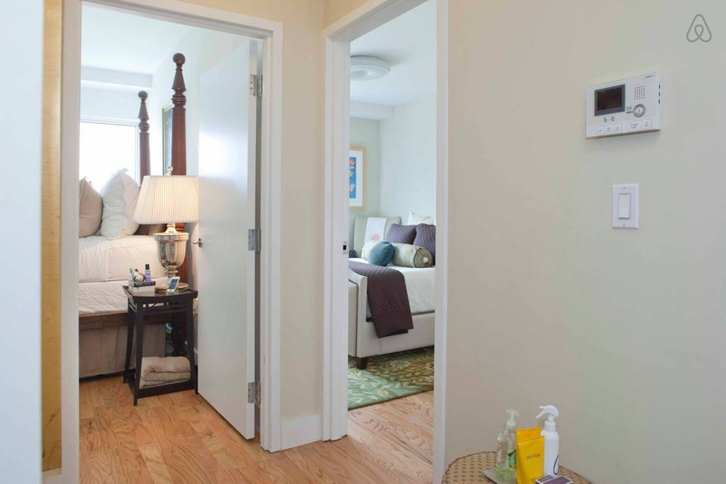 Entry way/hallway to the two bedrooms located on east side of apartment.