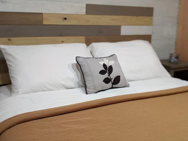 Comfortable Queen-size pillow top bed for a restful night away from home.