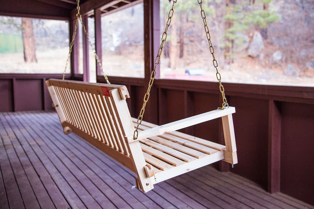 Porch swing on a large back porch, perfect for those cool summer nights.