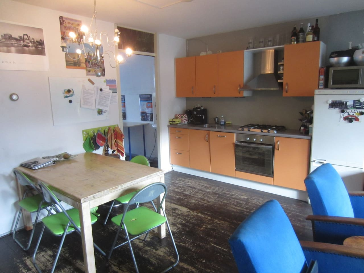 The kitchen and living room (the blue chairs are now replaced by 1 black one).