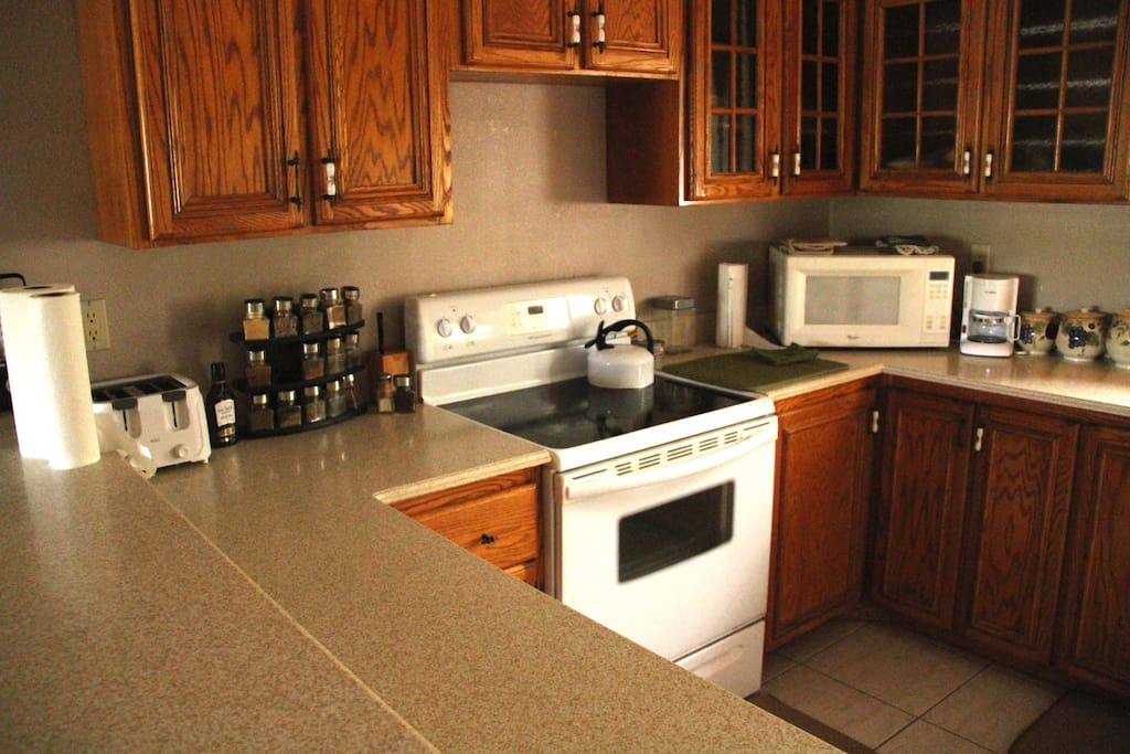 Kitchen has microwave, pots, pans, plates, glasses, silverware and everything else you need.