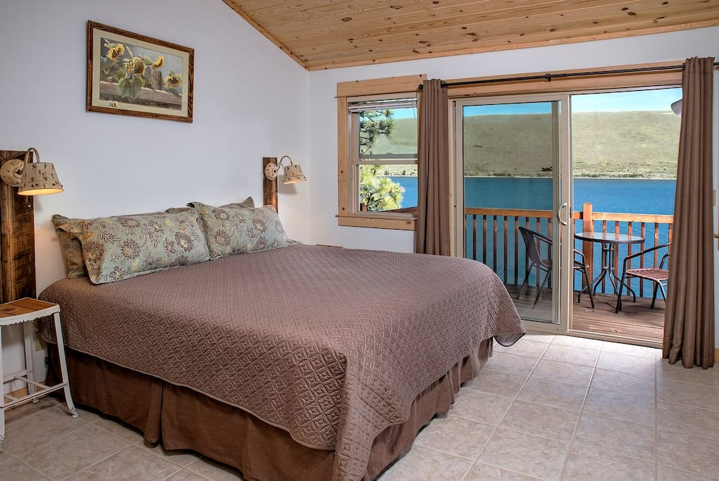 Upper bedroom has a private adjoining bath as well as a private balcony with outdoor furniture.