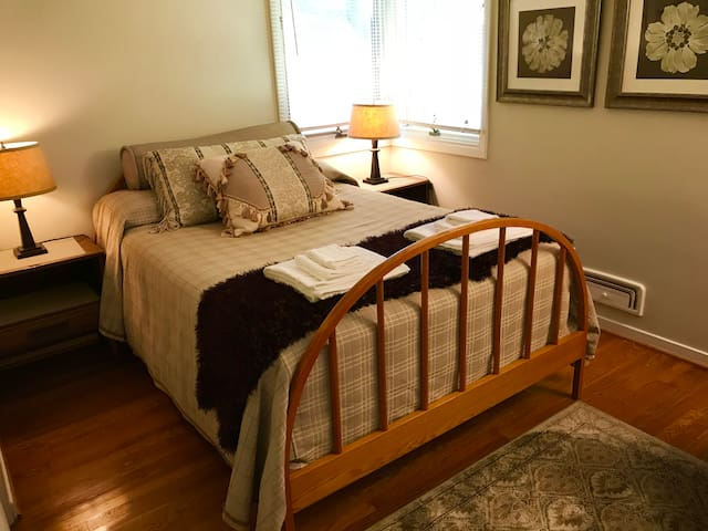 Bedroom 2 with double bed and comfy rocker for quiet moments