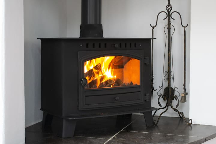 A cosy stove in a lofty space.