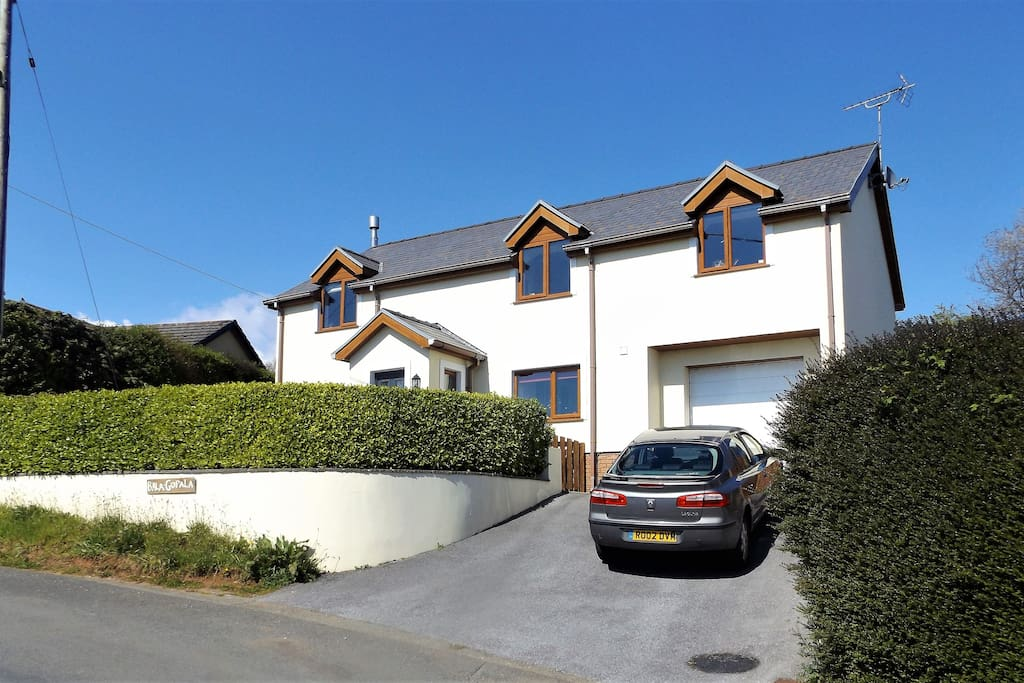Drive- way is rather steep but parking is available alongside the outside wall & hedge