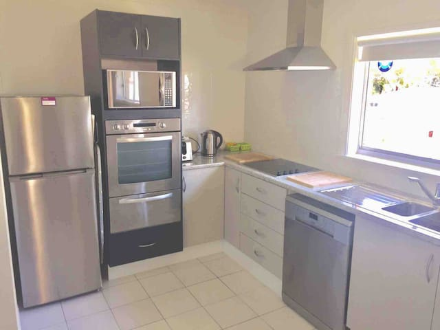 Updated full size kitchen with- Breakfast bar Oven Grill Ceramic glass cook top Range  Microwave  Toaster Kettle Dishwasher