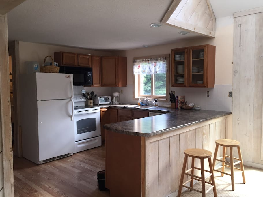 New, very functional kitchen fully stocked with everything necessary to cook a full meal