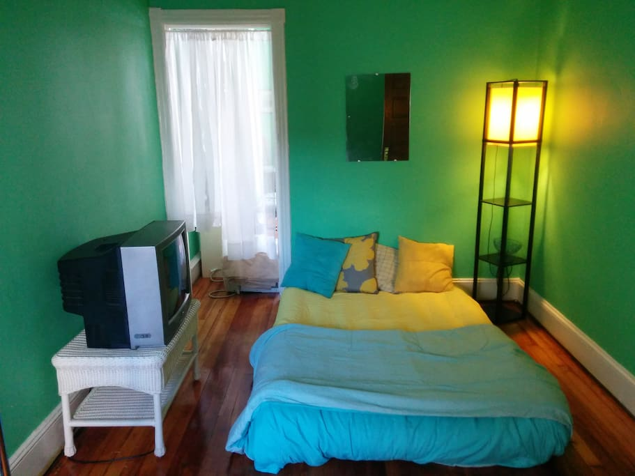 Additional bedroom with clothes rack and cable television