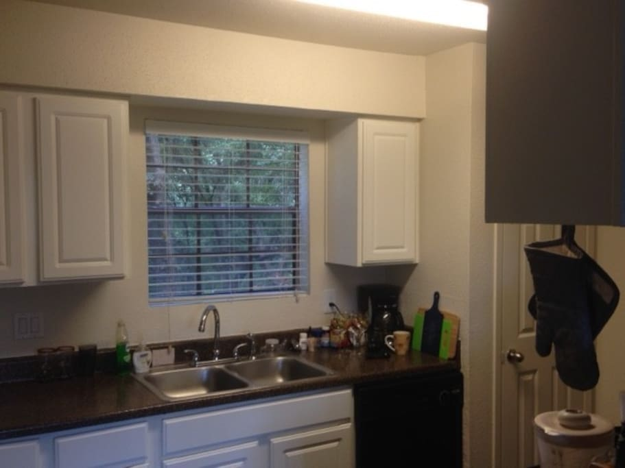 Kitchen includes fridge, stove/oven, microwave, toaster & coffee maker